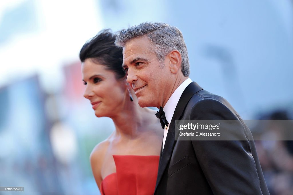 Actors <a gi-track='captionPersonalityLinkClicked' href=/galleries/search?phrase=Sandra+Bullock&family=editorial&specificpeople=202248 ng-click='$event.stopPropagation()'>Sandra Bullock</a> and <a gi-track='captionPersonalityLinkClicked' href=/galleries/search?phrase=George+Clooney&family=editorial&specificpeople=202529 ng-click='$event.stopPropagation()'>George Clooney</a> attend 'Gravity' premiere and Opening Ceremony during The 70th Venice International Film Festival at Sala Grande on August 28, 2013 in Venice, Italy.