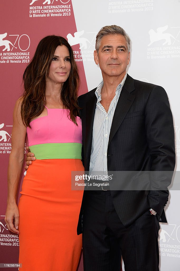Actors <a gi-track='captionPersonalityLinkClicked' href=/galleries/search?phrase=Sandra+Bullock&family=editorial&specificpeople=202248 ng-click='$event.stopPropagation()'>Sandra Bullock</a> and <a gi-track='captionPersonalityLinkClicked' href=/galleries/search?phrase=George+Clooney&family=editorial&specificpeople=202529 ng-click='$event.stopPropagation()'>George Clooney</a> attend the 'Gravity' photocall during the 70th Venice International Film Festival at the Palazzo del Casino on August 28, 2013 in Venice, Italy.