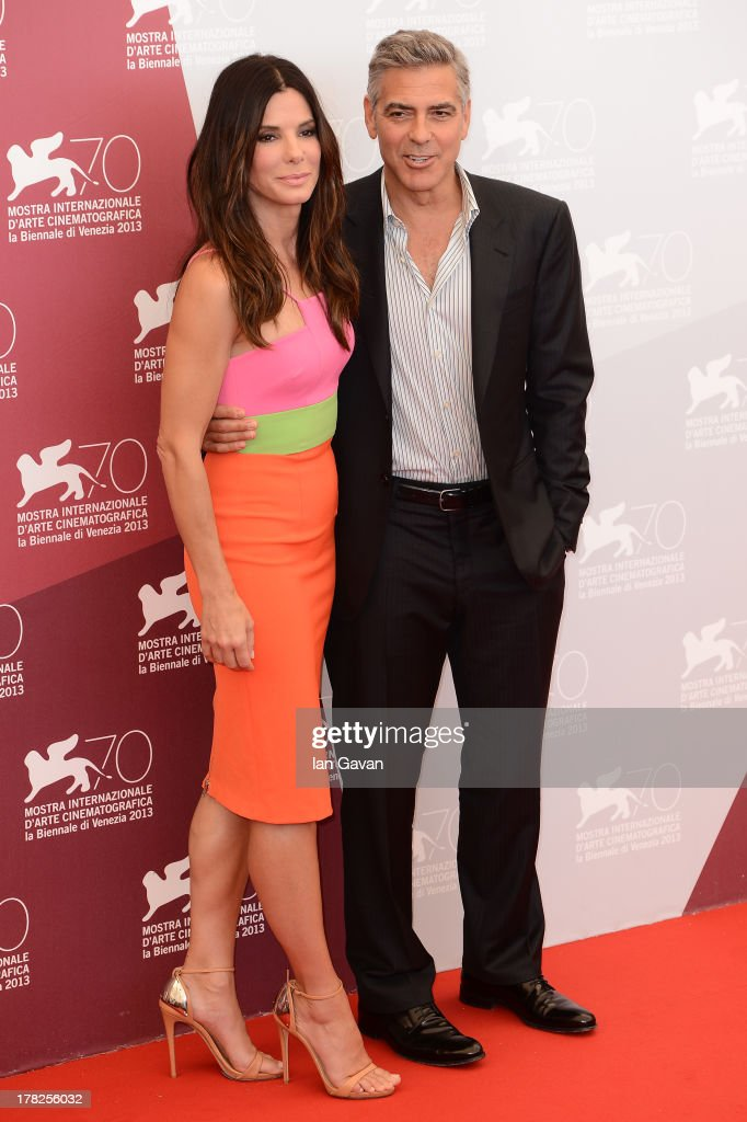 Actors Sandra Bullock and George Clooney attend the 'Gravity' photocall during the 70th Venice International Film Festival at the Palazzo del Casino on August 28, 2013 in Venice, Italy.