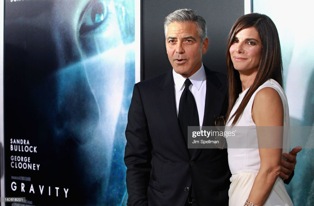 Actors <a gi-track='captionPersonalityLinkClicked' href=/galleries/search?phrase=Sandra+Bullock&family=editorial&specificpeople=202248 ng-click='$event.stopPropagation()'>Sandra Bullock</a> and <a gi-track='captionPersonalityLinkClicked' href=/galleries/search?phrase=George+Clooney&family=editorial&specificpeople=202529 ng-click='$event.stopPropagation()'>George Clooney</a> attend the 'Gravity' premiere at AMC Lincoln Square Theater on October 1, 2013 in New York City.