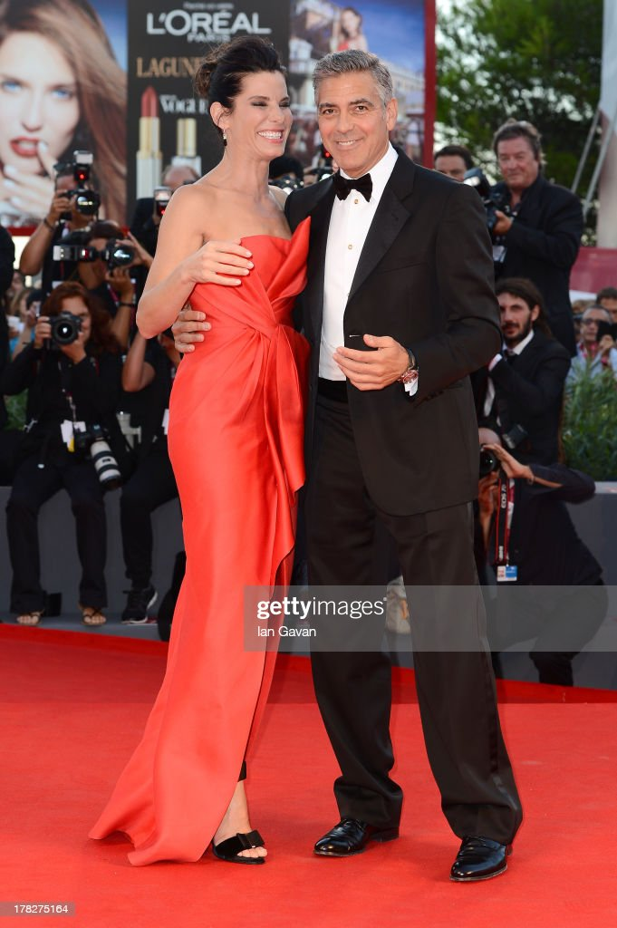 Actors Sandra Bullock and George Clooney attend the Opening Ceremony And 'Gravity' Premiere during the 70th Venice International Film Festival at the Palazzo del Cinema on August 28, 2013 in Venice, Italy.