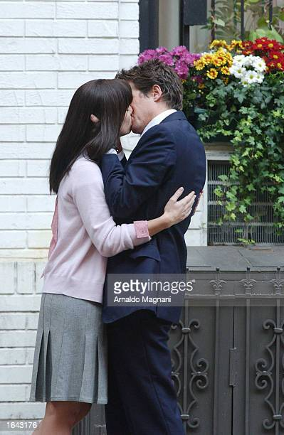 Actors Sandra Bullock and Hugh Grant kiss while filming a scene from the movie 'Two Weeks Notice' on 78th street and 2nd Avenue November 14 2002 in...