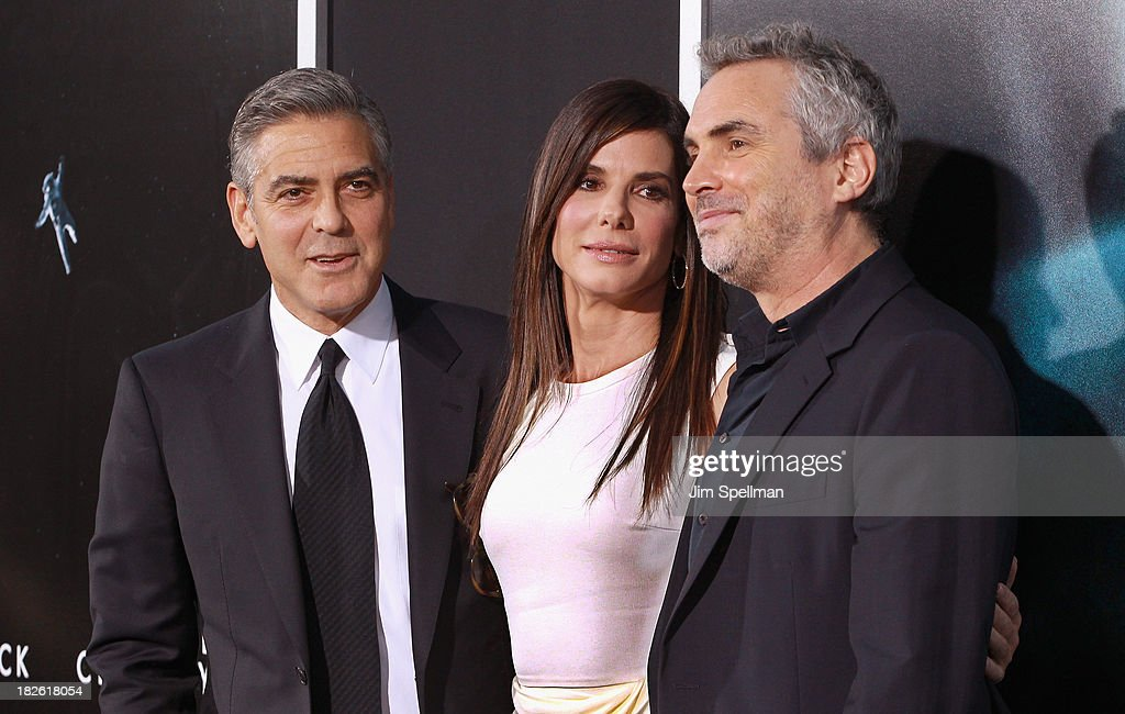 Actors <a gi-track='captionPersonalityLinkClicked' href=/galleries/search?phrase=Sandra+Bullock&family=editorial&specificpeople=202248 ng-click='$event.stopPropagation()'>Sandra Bullock</a>, <a gi-track='captionPersonalityLinkClicked' href=/galleries/search?phrase=George+Clooney&family=editorial&specificpeople=202529 ng-click='$event.stopPropagation()'>George Clooney</a> and director <a gi-track='captionPersonalityLinkClicked' href=/galleries/search?phrase=Alfonso+Cuaron&family=editorial&specificpeople=213792 ng-click='$event.stopPropagation()'>Alfonso Cuaron</a> attend the 'Gravity' premiere at AMC Lincoln Square Theater on October 1, 2013 in New York City.