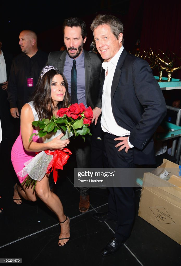 Actors <a gi-track='captionPersonalityLinkClicked' href=/galleries/search?phrase=Sandra+Bullock&family=editorial&specificpeople=202248 ng-click='$event.stopPropagation()'>Sandra Bullock</a>, <a gi-track='captionPersonalityLinkClicked' href=/galleries/search?phrase=Keanu+Reeves&family=editorial&specificpeople=171568 ng-click='$event.stopPropagation()'>Keanu Reeves</a> and Hugh Grant attend Spike TV's 'Guys Choice 2014' at Sony Pictures Studios on June 7, 2014 in Culver City, California.