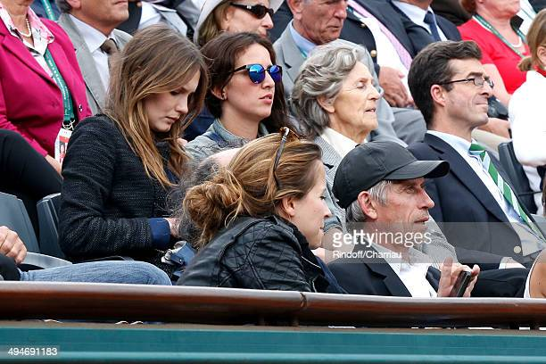 Actors Sara Giraudeau and Jacques Gamblin attend the Roland Garros French Tennis Open 2014 Day 6 on May 30 2014 in Paris France