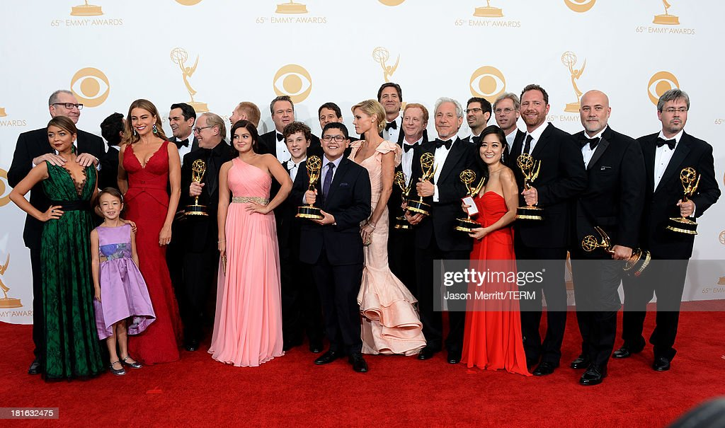 Actors Sarah Hyland, Aubrey Anderson-Emmons, Sofia Vergara, Ty Burrell, Jesse Tyler Ferguson, Ariel Winter, Nolan Gould, Eric Stonestreet, Rico Rodriguez, Julie Bowen and Ed O'Neill with show creator Steven Levitan and producers, winners of Outstanding Comedy Series for 'Modern Family,' pose in the press room during the 65th Annual Primetime Emmy Awards held at Nokia Theatre L.A. Live on September 22, 2013 in Los Angeles, California.