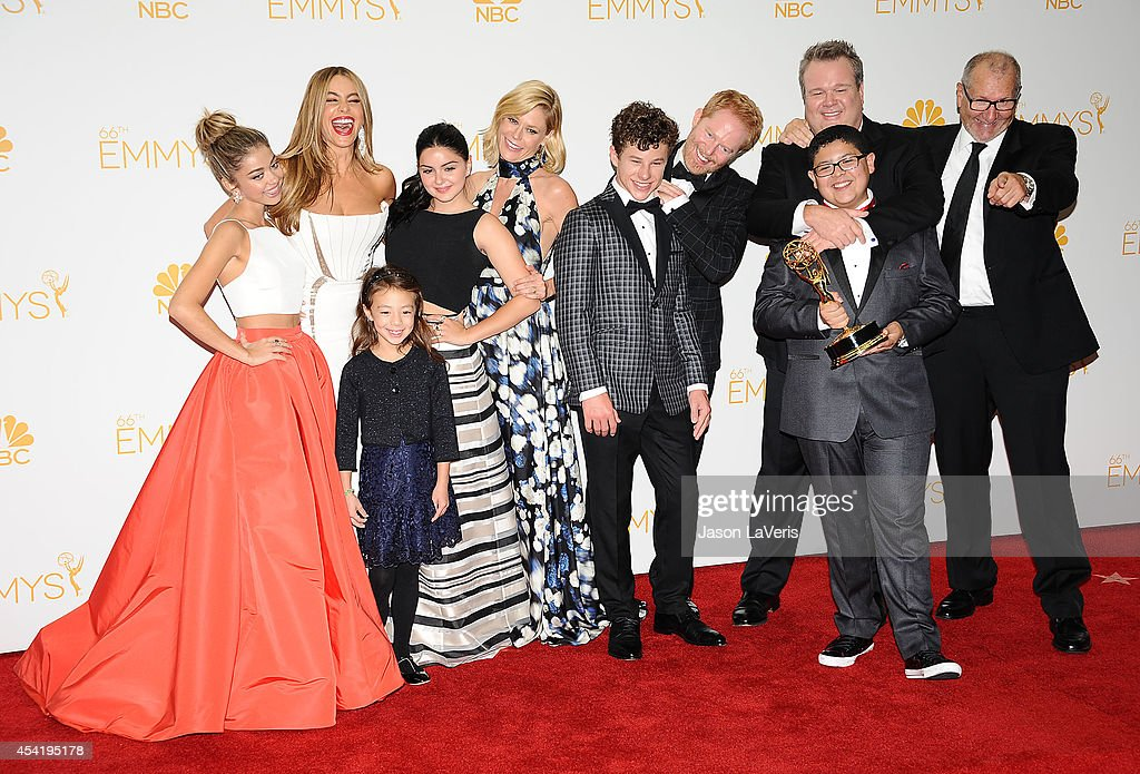 Actors Sarah Hyland, Sofia Vergara, Aubrey Anderson-Emmons, Ariel Winter, Julie Bowen, Jesse Tyler Ferguson, Nolan Gould, Rico Rodriguez, Eric Stonestreet, and Ed O'Neill, winners of Ouststanding Comedy Series for 'Modern Family' pose in the press room at the 66th annual Primetime Emmy Awards at Nokia Theatre L.A. Live on August 25, 2014 in Los Angeles, California.