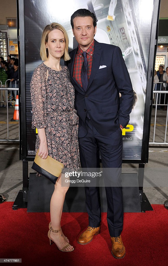 Actors <a gi-track='captionPersonalityLinkClicked' href=/galleries/search?phrase=Sarah+Paulson&family=editorial&specificpeople=220657 ng-click='$event.stopPropagation()'>Sarah Paulson</a> and Jason Butler Harner arrive at the Los Angeles premiere of 'Non-Stop' at Regency Village Theatre on February 24, 2014 in Westwood, California.