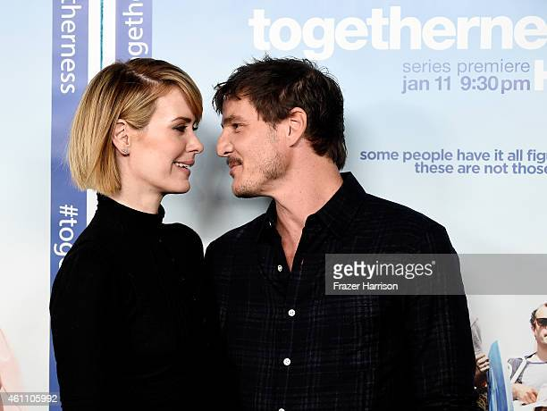Actors Sarah Paulson and Pedro Pascal arrive at the Premiere of HBO's 'Togetherness' at Avalon on January 6 2015 in Hollywood California