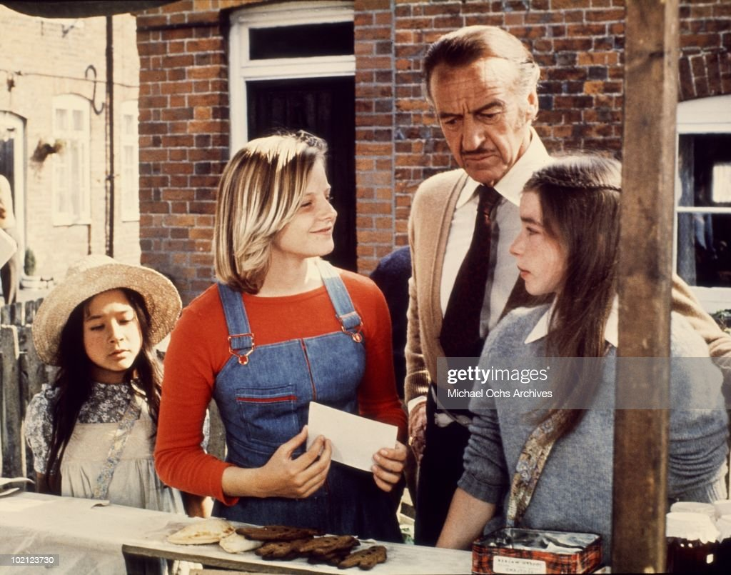 Actors (L-R) Sarah Tamakuni, Jodie Foster, David Niven and Veronica Quilligan in a scene from the movie 'Candleshoe' in 1977 in England.