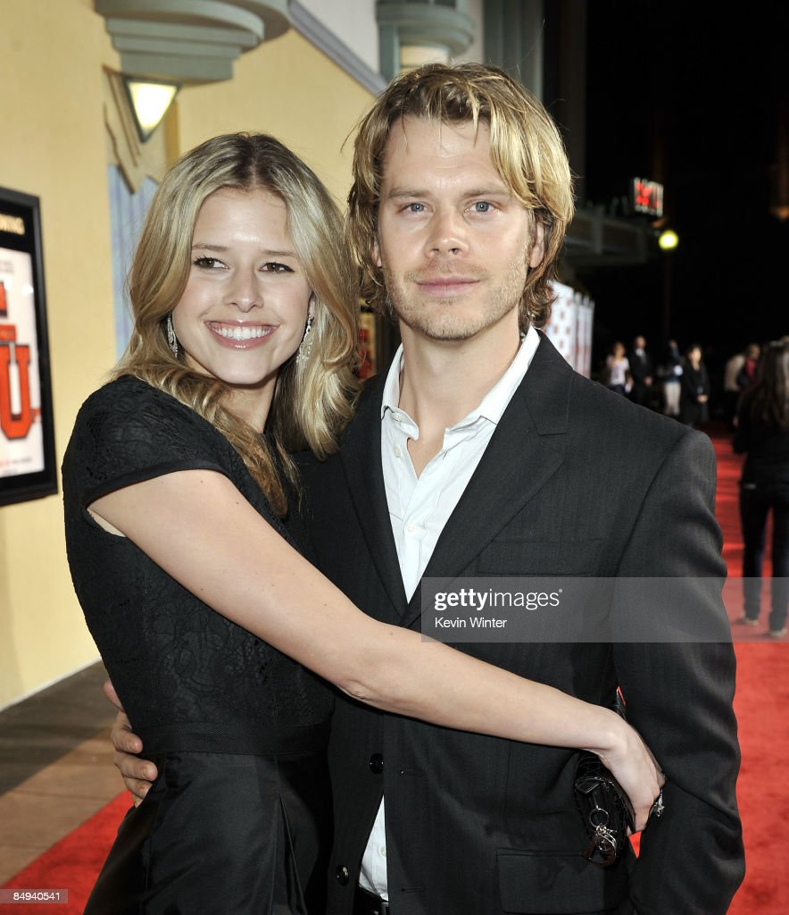 Actors Sarah Wright and Eric Christian Olsen pose at the premiere of Screen Gems' 'Fired Up' at the Pacific Culver Theatre on February 19 2009 in...