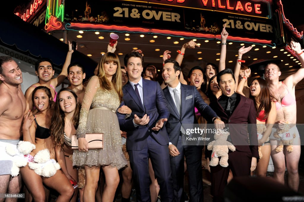 Actors Sarah Wright Miles Teller Skylar Astin and Justin Chon pose at the premiere of Relativity Media's '21 And Over' at the Village Theatre on...