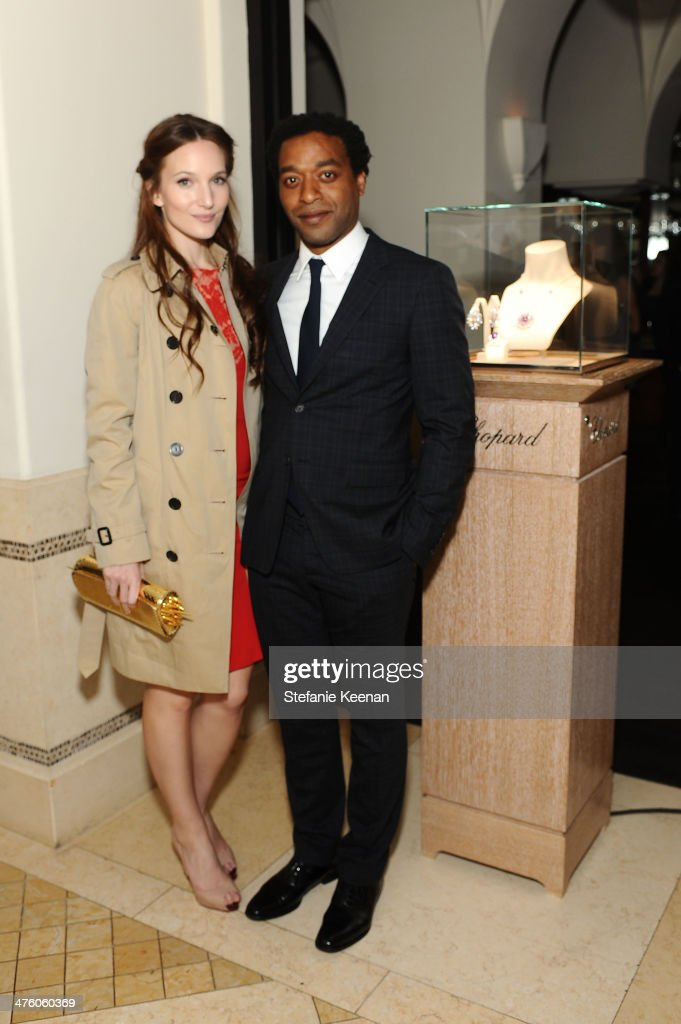 Actors Sari Mercer (L) and <a gi-track='captionPersonalityLinkClicked' href=/galleries/search?phrase=Chiwetel+Ejiofor&family=editorial&specificpeople=213998 ng-click='$event.stopPropagation()'>Chiwetel Ejiofor</a> attend The Weinstein Company Academy Award party hosted by Chopard on March 1, 2014 in Beverly Hills, California.
