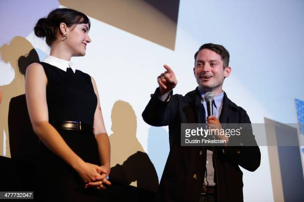 Actors Sasha Grey and Elijah Wood speak onstage at the 'Open Windows' Photo Op and QA during the 2014 SXSW Music Film Interactive Festival at Alamo...