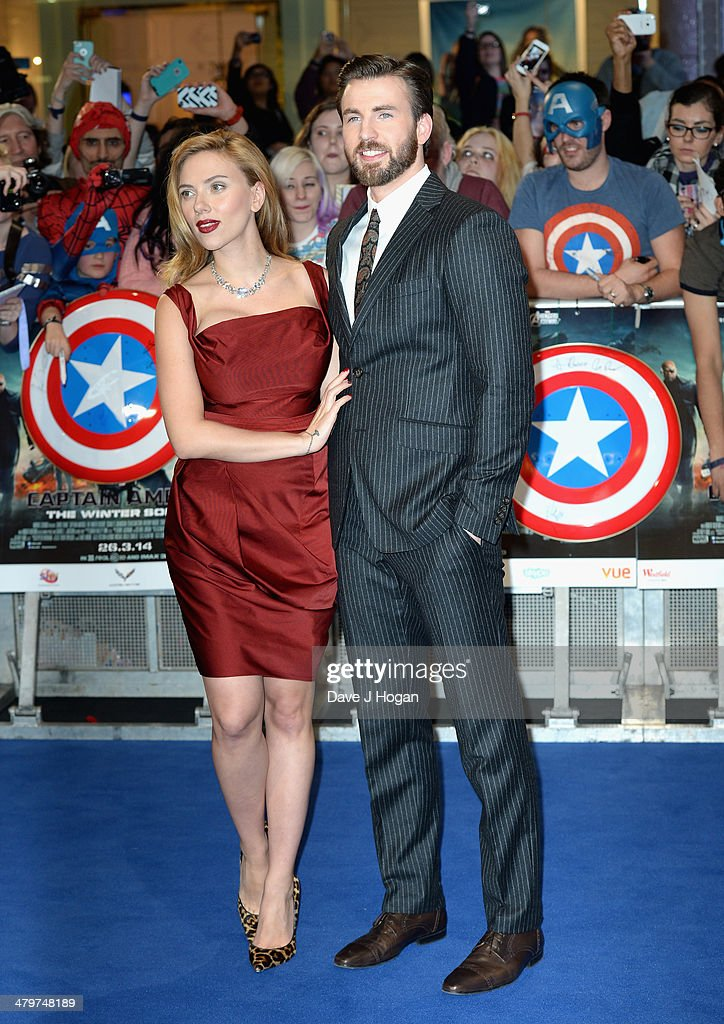 Actors Scarlett Johansson and Chris Evans attend the 'Captain America: The Winter Soldier' UK film premiere at Westfield on March 20, 2014 in London, England.