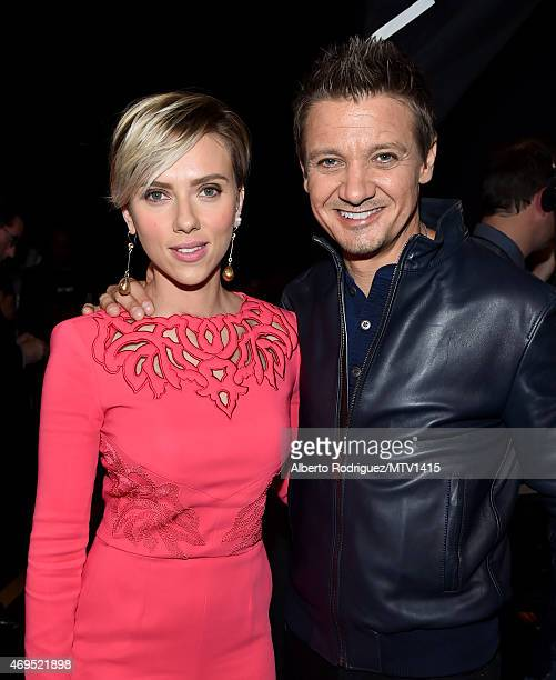 Actors Scarlett Johansson and Jeremy Renner attend The 2015 MTV Movie Awards at Nokia Theatre LA Live on April 12 2015 in Los Angeles California