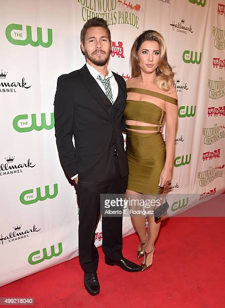 Actors Scott Clifton and Jacqueline MacInnes Wood attend 2015 Hollywood Christmas Parade on November 29 2015 in Hollywood California