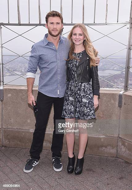 Actors Scott Eastwood and Britt Robertson pose for pictures whie visitng The Empire State Building on April 9 2015 in New York City