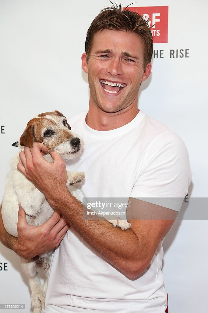 Actors <a gi-track='captionPersonalityLinkClicked' href=/galleries/search?phrase=Scott+Eastwood&family=editorial&specificpeople=5793075 ng-click='$event.stopPropagation()'>Scott Eastwood</a> and Uggie attend Abercrombie & Fitch's presentation of their 2013 Stars on the Rise at The Grove on July 11, 2013 in Los Angeles, California.