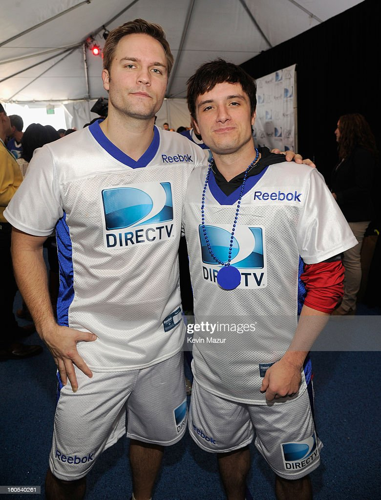 Actors Scott Porter and Josh Hutcherson attend DIRECTV'S 7th annual celebrity Beach Bowl at DTV SuperFan Stadium at Mardi Gras World on February 2, 2013 in New Orleans, Louisiana.