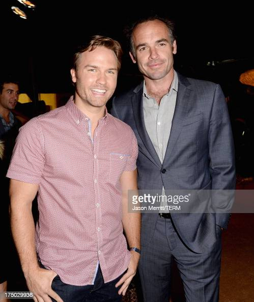 Actors Scott Porter and Paul Blackthorne attend the CW CBS and Showtime 2013 summer TCA party on July 29 2013 in Los Angeles California