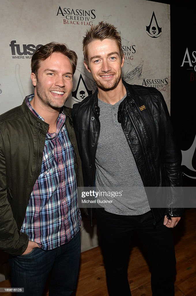 Actors Scott Porter (L) and Robert Buckley attend the Assasin's Creed IV Black Flag Launch Party at Greystone Manor Supperclub on October 22, 2013 in West Hollywood, California.