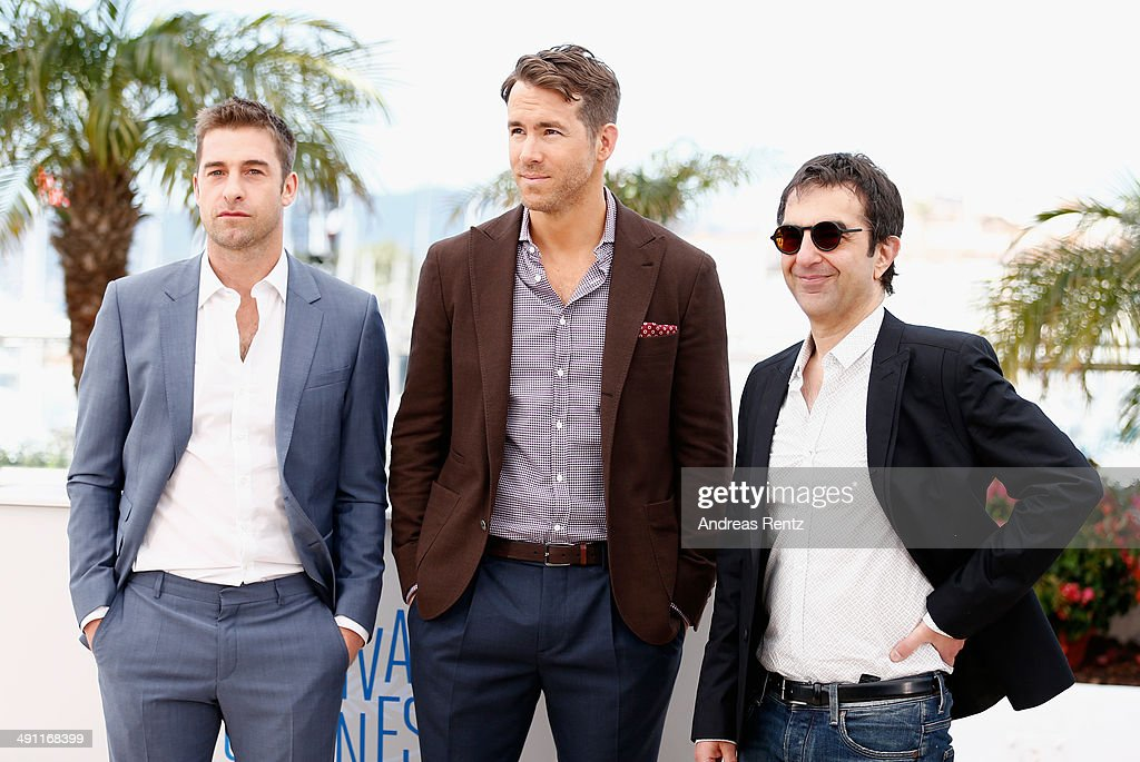 Actors <a gi-track='captionPersonalityLinkClicked' href=/galleries/search?phrase=Scott+Speedman&family=editorial&specificpeople=211282 ng-click='$event.stopPropagation()'>Scott Speedman</a>, <a gi-track='captionPersonalityLinkClicked' href=/galleries/search?phrase=Ryan+Reynolds&family=editorial&specificpeople=204149 ng-click='$event.stopPropagation()'>Ryan Reynolds</a> and Director <a gi-track='captionPersonalityLinkClicked' href=/galleries/search?phrase=Atom+Egoyan&family=editorial&specificpeople=215428 ng-click='$event.stopPropagation()'>Atom Egoyan</a> attend the 'Captives' photocall during the 67th Annual Cannes Film Festival on May 16, 2014 in Cannes, France.