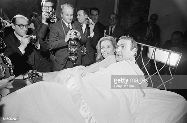 Actors Sean Connery and Luciana Paluzzi being photographed in bed on the set of the James Bond film 'Thunderball' 8th March 1965