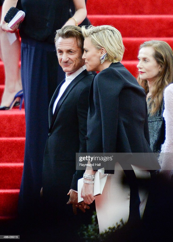 Actors Sean Penn (L) and Charlize Theron attend the 'Charles James: Beyond Fashion' Costume Institute Gala held at the Metropolitan Museum of Art on May 5, 2014 in New York City.