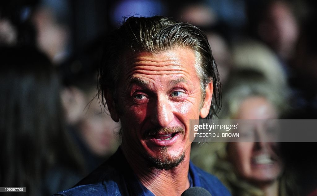 Actors Sean Penn responds to questions on arrival for the Los Angeles World Premiere of the film 'Gangster Squad' at Grauman's Chinese Theater on January 7, 2013 in Hollywood,California. The film opens nationwide on January 11. AFP PHOTO / Frederic J. BROWN