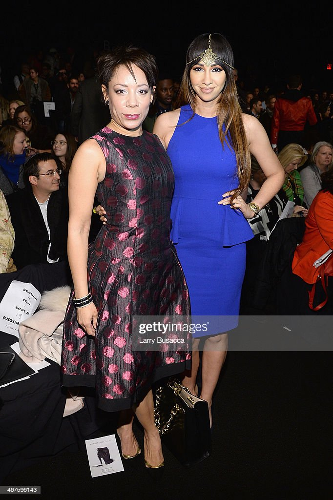 Actors Selenis Leyva (L) and Jackie Cruz attend Carmen Marc Valvo fashion show during Mercedes-Benz Fashion Week Fall 2014 at The Salon at Lincoln Center on February 7, 2014 in New York City.