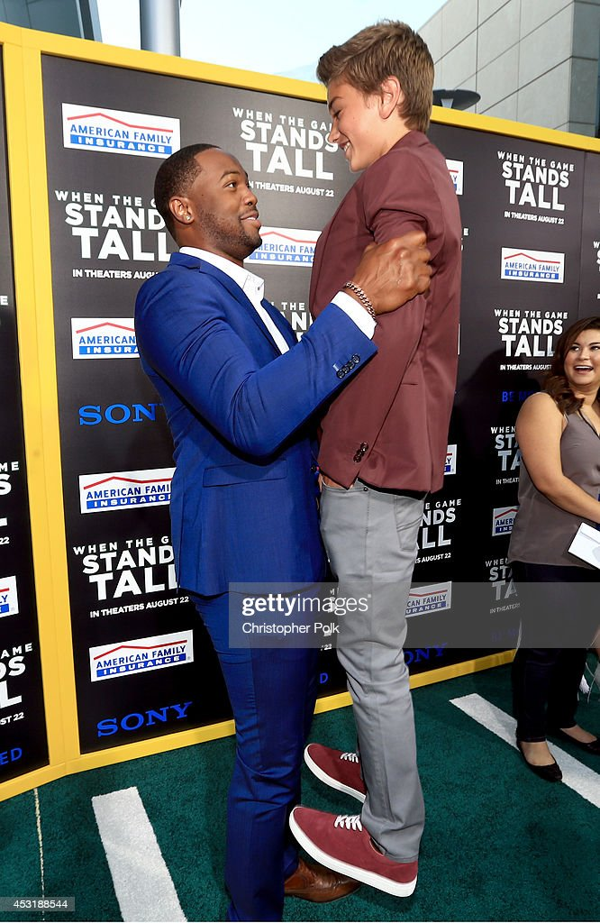 Actors Ser'Darius Blain (L) and Gavin Casalegno attend the premiere of Tri Star Pictures' 'When The Game Stands Tall' at ArcLight Cinemas on August 4, 2014 in Hollywood, California.