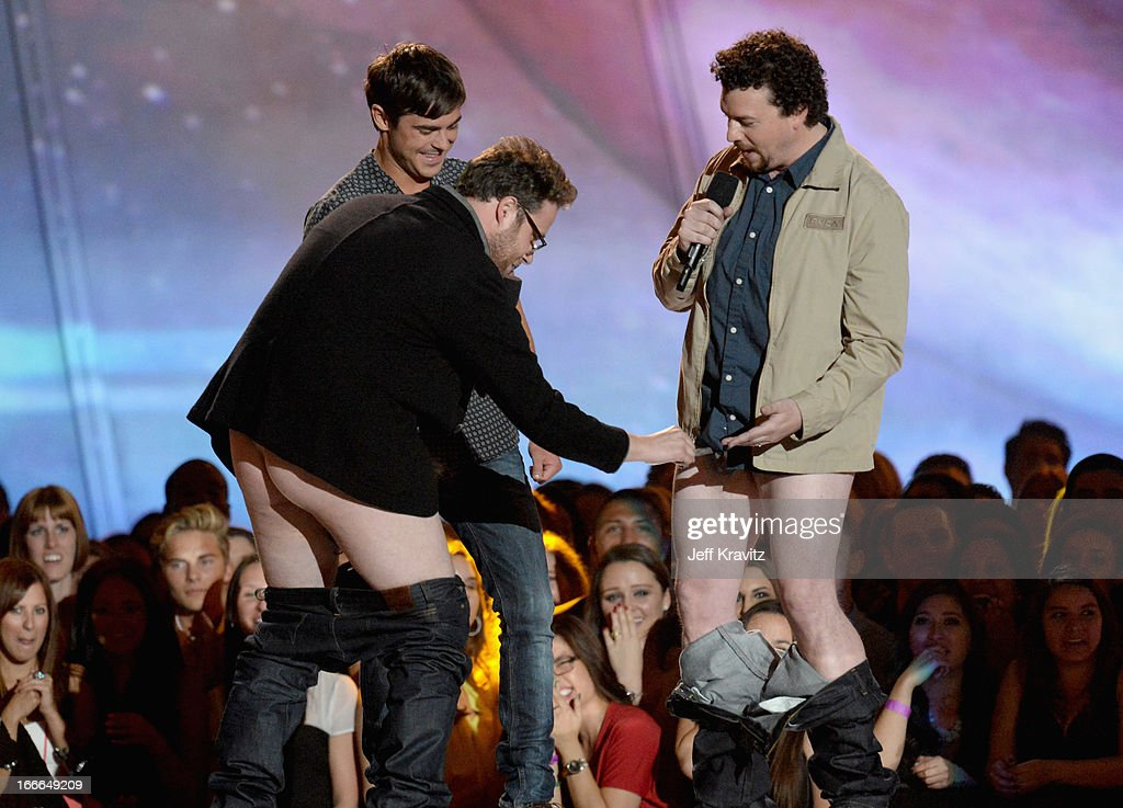 Actors Seth Rogen, Zac Efron and Danny McBride speak onstage during the 2013 MTV Movie Awards at Sony Pictures Studios on April 14, 2013 in Culver City, California.