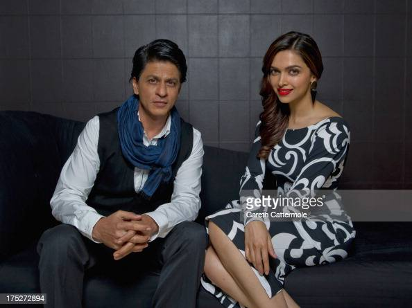 Actors Shah Rukh Khan and Deepika Padukone pose together during a portrait session at The Courthouse Hotel on July 30 2013 in London England