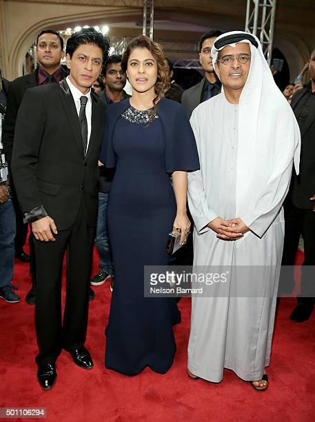 Actors Shah Rukh Khan Kajol Devgan and DIFF Chairman Abdulhamid Juma attend 'The Clan' premiere during day four of the 12th annual Dubai...
