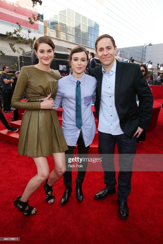 Actors <a gi-track='captionPersonalityLinkClicked' href=/galleries/search?phrase=Shailene+Woodley&family=editorial&specificpeople=676833 ng-click='$event.stopPropagation()'>Shailene Woodley</a> and <a gi-track='captionPersonalityLinkClicked' href=/galleries/search?phrase=Ellen+Page&family=editorial&specificpeople=623049 ng-click='$event.stopPropagation()'>Ellen Page</a> and guest attend the 2014 MTV Movie Awards at Nokia Theatre L.A. Live on April 13, 2014 in Los Angeles, California.