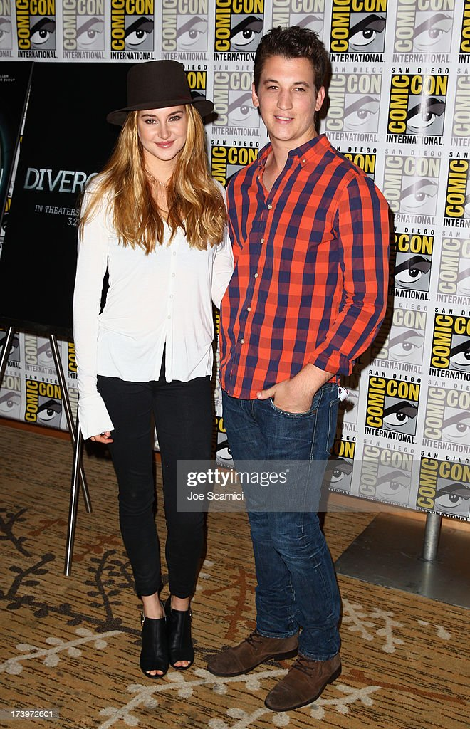 Actors <a gi-track='captionPersonalityLinkClicked' href=/galleries/search?phrase=Shailene+Woodley&family=editorial&specificpeople=676833 ng-click='$event.stopPropagation()'>Shailene Woodley</a> and <a gi-track='captionPersonalityLinkClicked' href=/galleries/search?phrase=Miles+Teller&family=editorial&specificpeople=6471673 ng-click='$event.stopPropagation()'>Miles Teller</a> attend 'Divergent' Comic-Con Press Line at San Diego Convention Center on July 18, 2013 in San Diego, California.