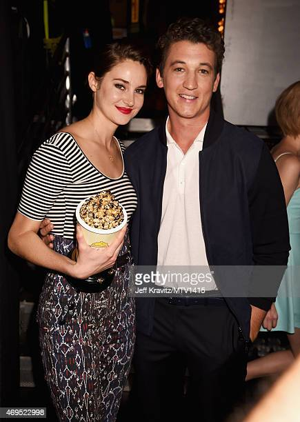 Actors Shailene Woodley and Miles Teller attend The 2015 MTV Movie Awards at Nokia Theatre LA Live on April 12 2015 in Los Angeles California