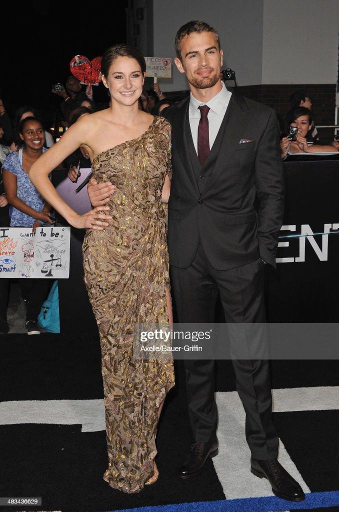 Actors <a gi-track='captionPersonalityLinkClicked' href=/galleries/search?phrase=Shailene+Woodley&family=editorial&specificpeople=676833 ng-click='$event.stopPropagation()'>Shailene Woodley</a> and <a gi-track='captionPersonalityLinkClicked' href=/galleries/search?phrase=Theo+James&family=editorial&specificpeople=7989783 ng-click='$event.stopPropagation()'>Theo James</a> arrive at the Los Angeles Premiere of 'Divergent' at Regency Bruin Theatre on March 18, 2014 in Los Angeles, California.