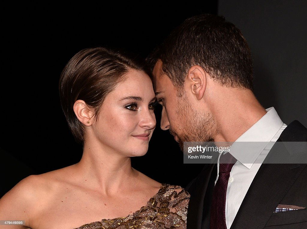 Actors <a gi-track='captionPersonalityLinkClicked' href=/galleries/search?phrase=Shailene+Woodley&family=editorial&specificpeople=676833 ng-click='$event.stopPropagation()'>Shailene Woodley</a> (L) and <a gi-track='captionPersonalityLinkClicked' href=/galleries/search?phrase=Theo+James&family=editorial&specificpeople=7989783 ng-click='$event.stopPropagation()'>Theo James</a> arrive at the premiere of Summit Entertainment's 'Divergent' at the Regency Bruin Theatre on March 18, 2014 in Los Angeles, California.