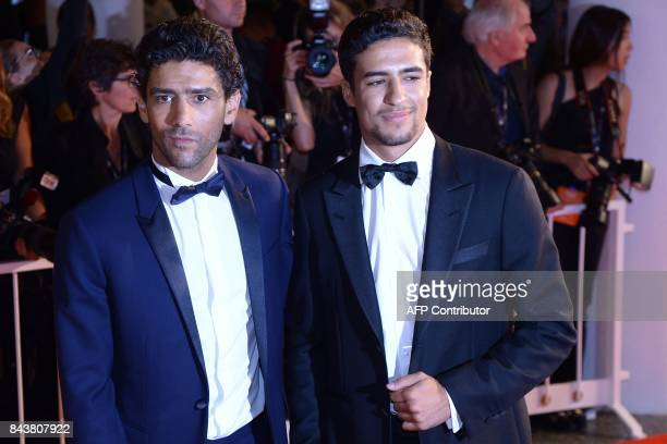 Actors Shain Boumedine and Salim Kechiouche attend the premiere of the movie 'Mektoub My Love Canto Uno' presented in competition at the 74th Venice...