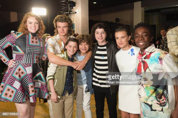 Actors Shannon Purser Joe Keery Noah Schnapp Gaten Matarazzo Finn Wolfhard Millie Bobby Brown and Caleb McLaughlin attend the 2017 MTV Movie And TV...