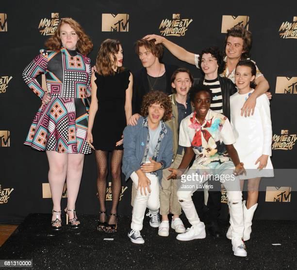 Actors Shannon Purser Natalia Dyer Charlie Heaton Gaten Matarazzo Caleb McLaughlin Noah Schnapp Finn Wolfhard Joe Keery and Millie Bobby Brown of...