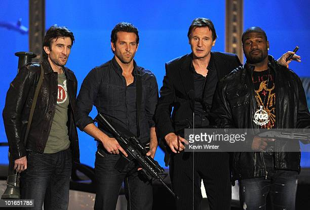 Actors Sharlto Copley Bradley Cooper Liam Neeson and Quinton Jackson speak onstage during Spike TV's 4th Annual 'Guys Choice Awards' held at Sony...