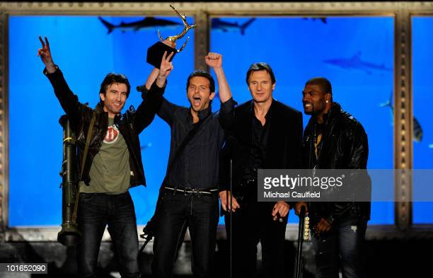 Actors Sharlto Copley Bradley Cooper Liam Neeson and Quinton Jackson speaks onstage during Spike TV's 4th Annual 'Guys Choice Awards' held at Sony...