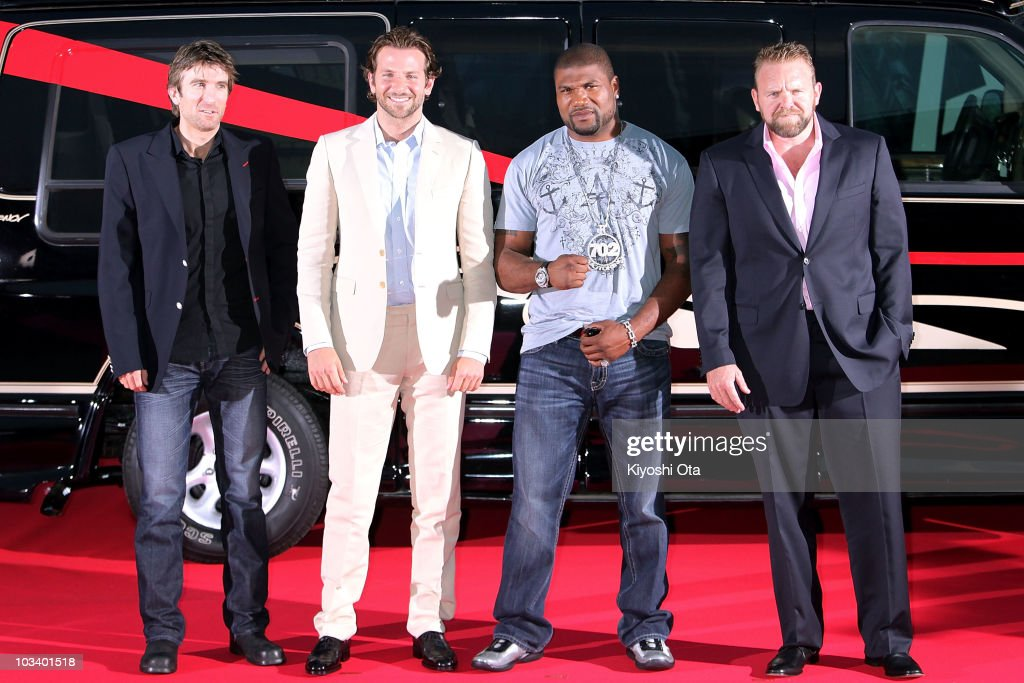 Actors Sharlto Copley Bradley Cooper Quinton 'Rampage' Jackson and director Joe Carnahan pose on the red carpet during the Japan Premiere of 'The...