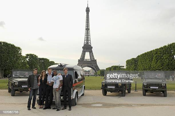 Actors Sharlto Copley Jessica Biel Liam Neeson Quinton 'Rampage' Jackson and Bradley Cooper pose during 'L'agence Tous Risques' Paris Photocall at...