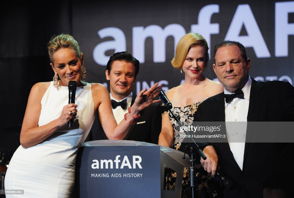 Actors Sharon Stone, Jeremy Renner and Nicole Kidman with producer Harvey Weinstein on stage at amfAR's 20th Annual Cinema Against AIDS during The 66th Annual Cannes Film Festival at Hotel du Cap-Eden-Roc on May 23, 2013 in Cap d'Antibes, France.