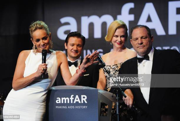 Actors Sharon Stone Jeremy Renner and Nicole Kidman with producer Harvey Weinstein on stage at amfAR's 20th Annual Cinema Against AIDS during The...