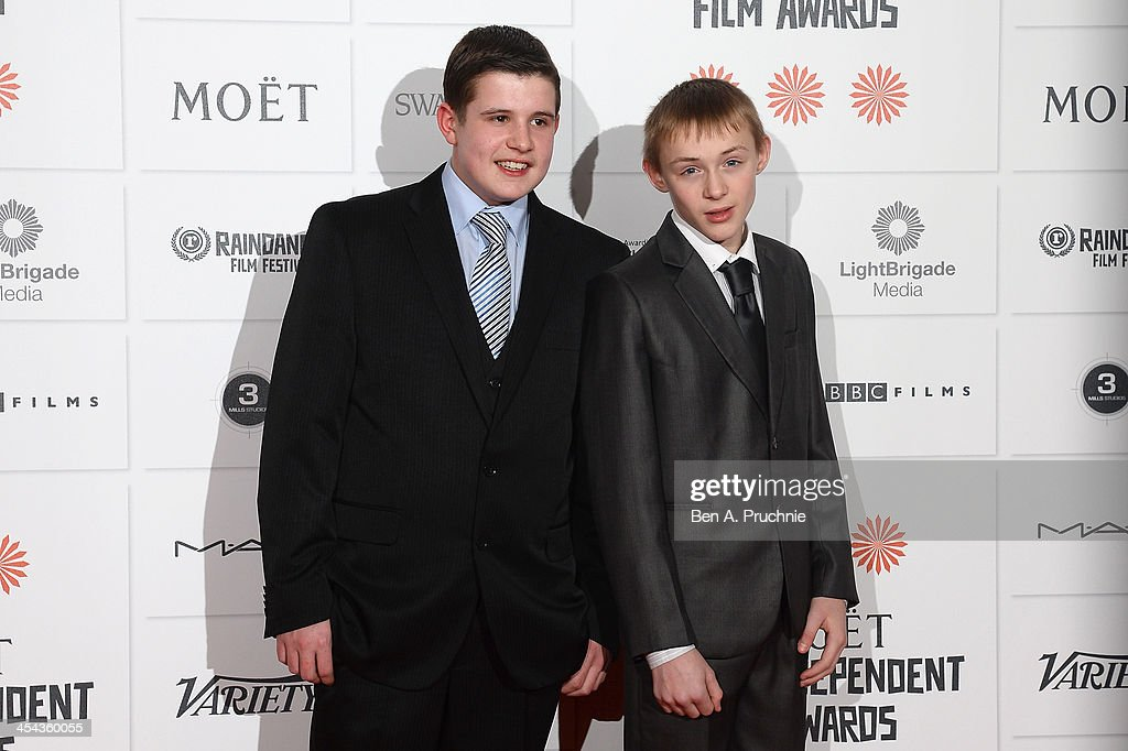 Actors Shaun Thomas and Conner Chapman arrive on the red carpet for the Moet British Independent Film Awards at Old Billingsgate Market on December 8, 2013 in London, England.